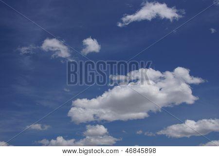Deep Blue Sky And Fluffy Cumulous Cloud
