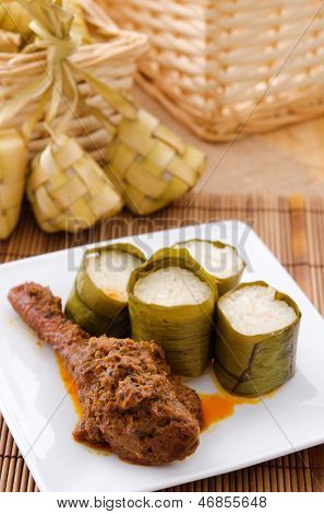 Lemak Lemang, traditional Malaysian food made of glutinous rice, coconut milk and salt. Cooked in a hollowed bamboo stick lined with banana leaves. Served during ramadan festival or hari raya. poster