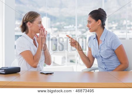 Businesswoman pointing to a colleague in their office
