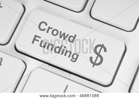 Crowd funding button on a white keyboard poster