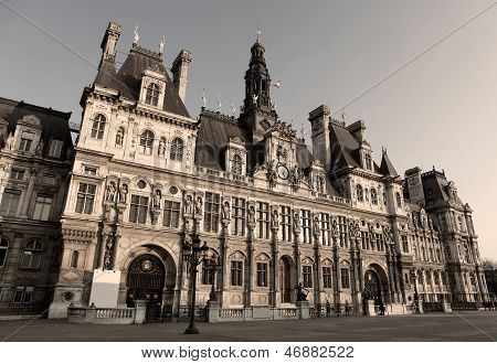 Town Hall of Paris known as the Hotel de Ville or Mairie is the seat of the municipality of Paris (sepia image). The building and all the statues in front were created before 1880 poster