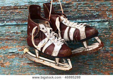 Vintage Pair Of Mens  Ice Skates On A Wooden Wall