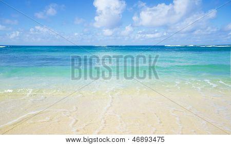 Gentle wave on the sandy Poipu beach in Hawaii Kauai poster