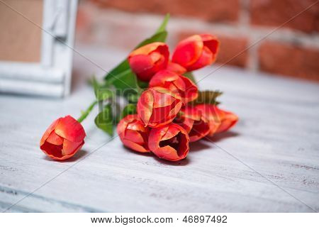 bouquet of tulips on a white table poster