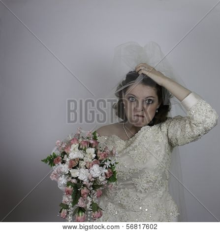 Young bride making face