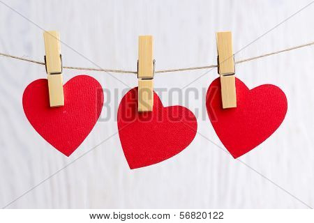 Red Hearts Hanging On Wooden Background
