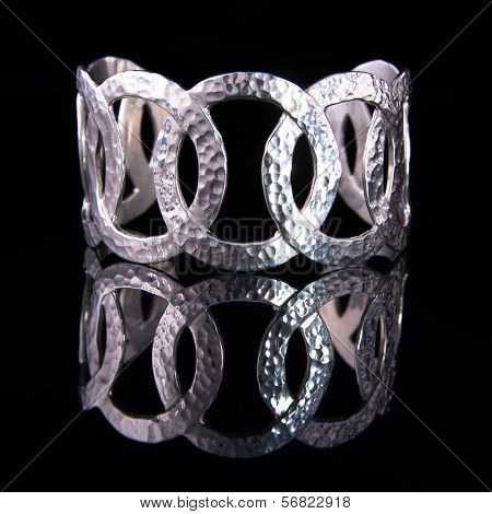 Beautiful silver bracelet on black background