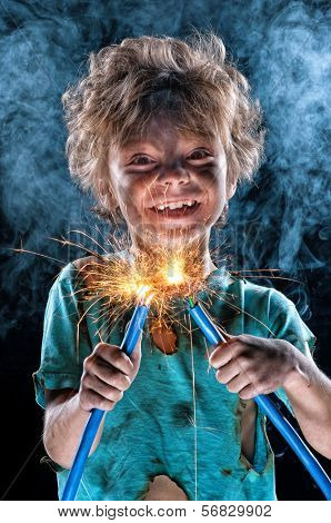 Portrait of little crazy electrician over black background