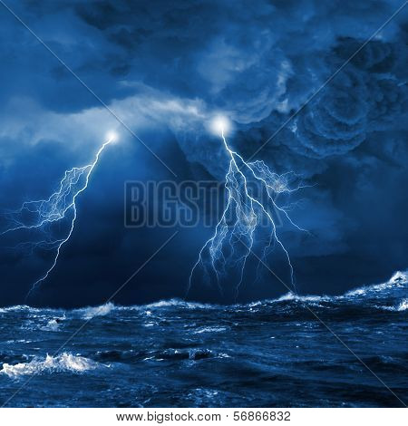 Image of dark night with lightning above stormy sea poster