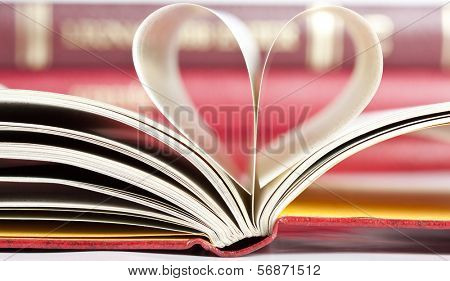 Close up on heart shaped book pages