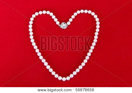 Pearl necklace on a red background