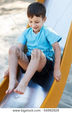 Preschooler Boy On Slide