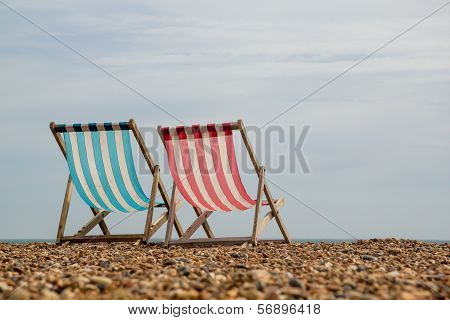 2 Deck Chairs Facing The Sea On Brighton Beach, England