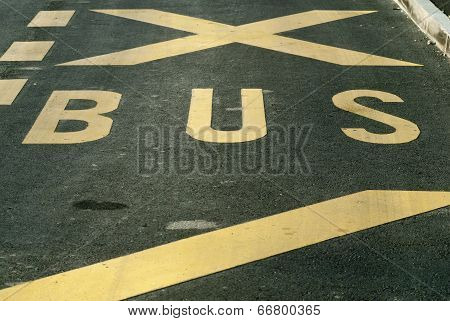 Bus Sign On Asphalt