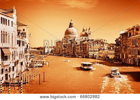 Venice, Italy. Grand Canal and Basilica Santa Maria della Salute at sunny day. View from Ponte dell Accademia. Vintage, monochrome gold