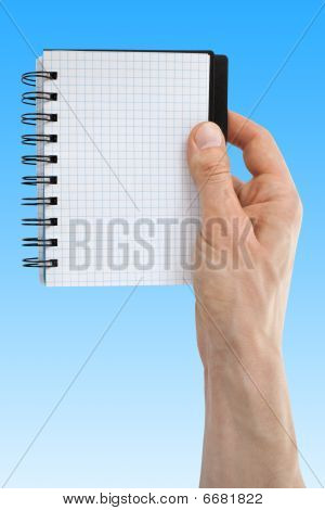 Hand With Blank White Paper Notebook