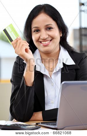 Young business woman holding credit card