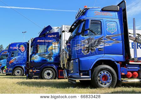 Row Of Heavy Trucks With Artwork In A Show