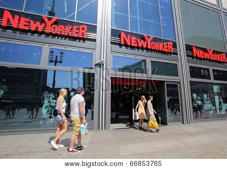 BERLIN, GERMANY - JUNE 11, 2014: Pedestrians walk past a NewYorker clothing store in  Berlin, Germany, on Saturday, June 11, 2014.