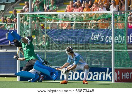 THE HAGUE, NETHERLANDS - JUNE 1. Netherlands scores from a penalty corner against Argentina (3-1) Goalie Juan Vivaldi cant stop the ball in the top left corner of the goal  in 2014