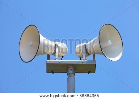 Outside loudspeaker against nice blue sky