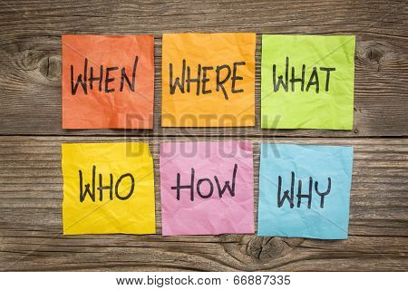 where, when, who, what, why, how questions - uncertainty, brainstorming or decision making concept, colorful crumpled sticky notes on grained wood poster