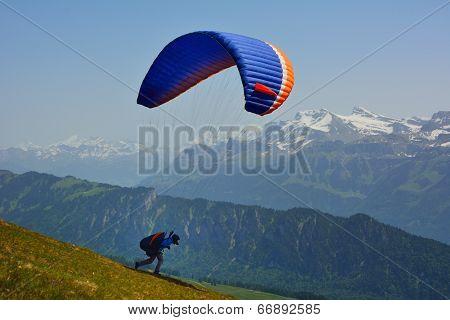 Paraglider In The Alps Switzerland On Summer