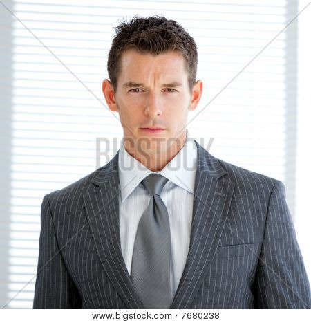 Portrait Of A Charismatic Businessman Standng