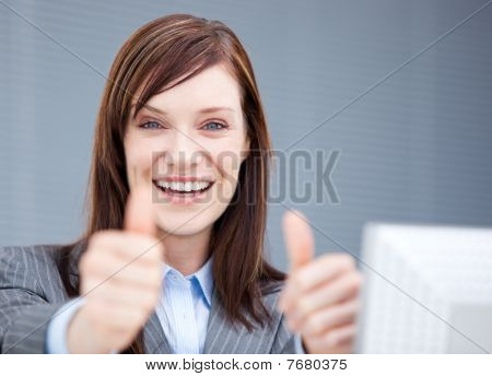 Jolly Businesswoman With Thumbs Up