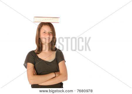 Teen balancing book on her head