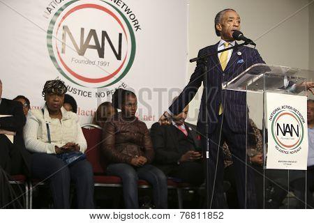 Rev Al Sharpton gestures for emphasis