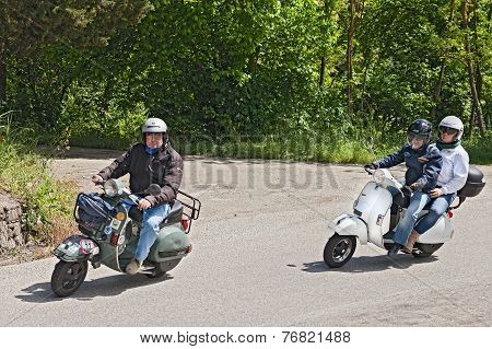 Bikers Riding Vintage Italian Scooter Vespa
