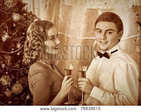Couple on party near Christmas tree.