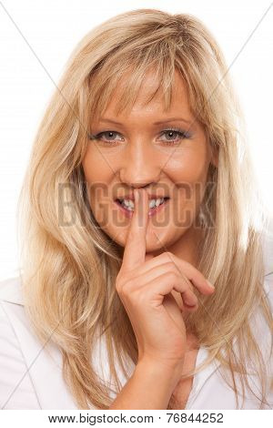 Woman asking for silence or secrecy with finger on lips hush hand gesture. Isolated poster