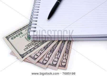 Pen, Notebook And Some Dollars