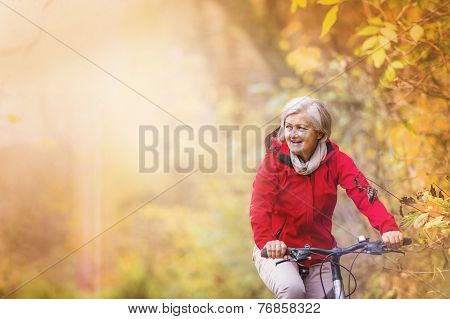 Active senior woman ridding bike