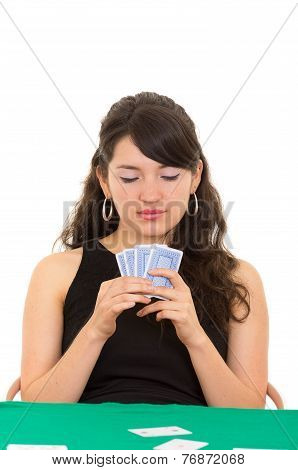 Young beautiful girl playing cards