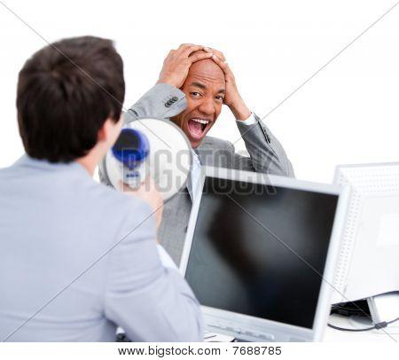 Stressed Businessman Yelling Through A Megaphone