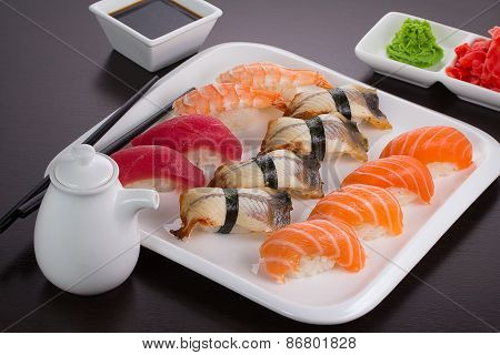Japanese Cuisine. Set Of Sushi Nigiri On White Plate.