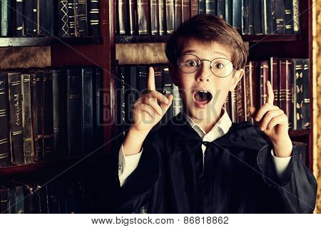 Smart boy stands in the library by the bookshelves with many old books. Educational concept. Science. Vintage style. poster