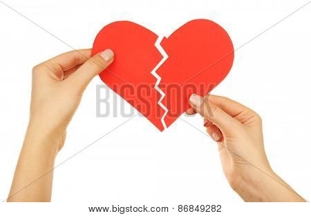 Female hands holding broken heart isolated on white
