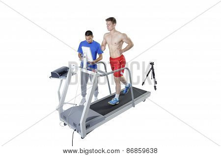 Sports Scientist Doing Performance Assessment With Treadmill And High Speed Camera. Modern Technolog