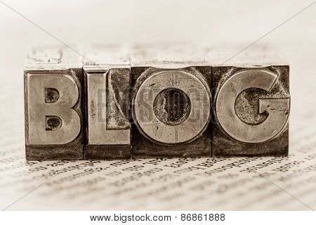 the word blog written with lead letters. photo icon for blog