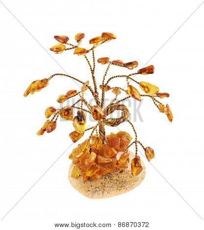 Tree statuette made of amber stones, isolated over white background poster