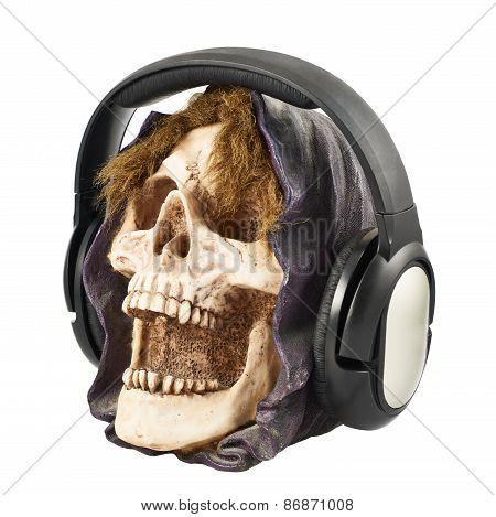 Headphones put on a ceramic skull head