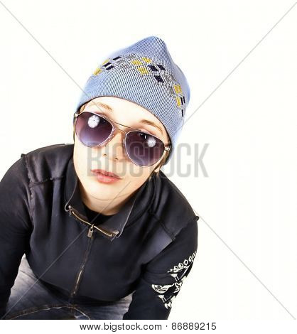 a cute girl with a beanie hat on isolated on white studio shot