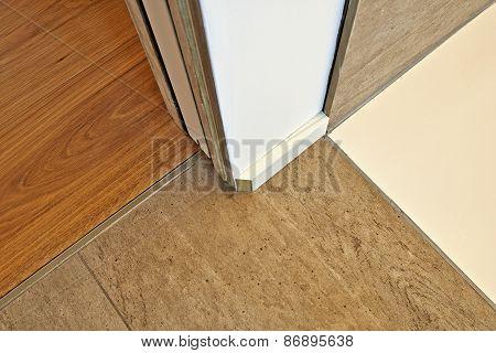Marble and hardwood floor between door and before finition poster