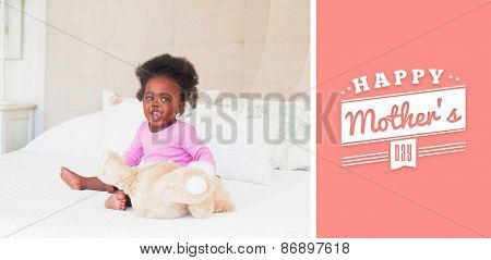 mothers day greeting against baby girl in pink babygro sitting on bed