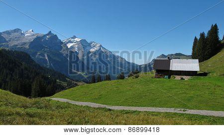 Summer scene on the trekking route from Lauenen to Gsteig bei Gstaad. poster