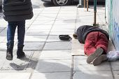 THESSALONIKI GREECE MARCH 28 2015: Homeless in Greece face continuing financial crisis. Homeless of Thessaloniki often begging for food or money sleeping rough outside shops or in public parks poster